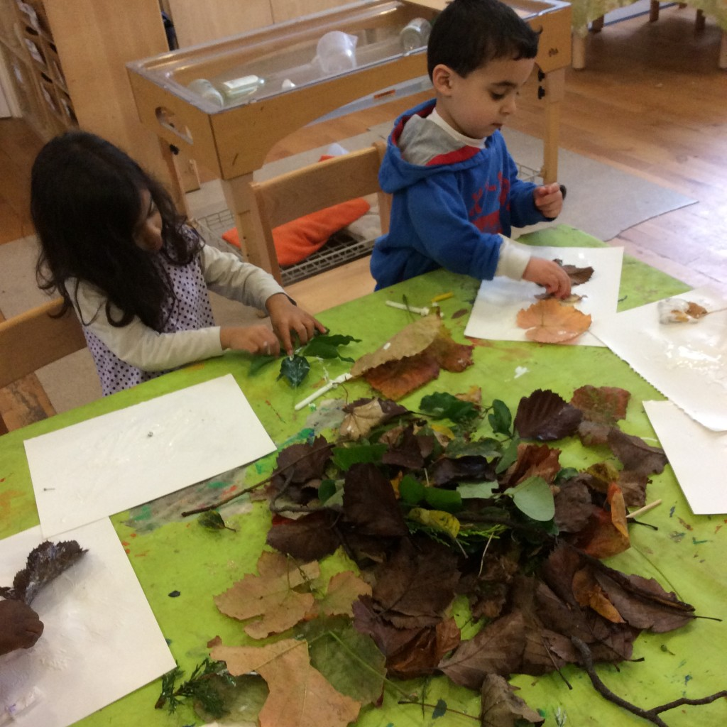 Discussing our nature walk collection and working on art pieces to take home.